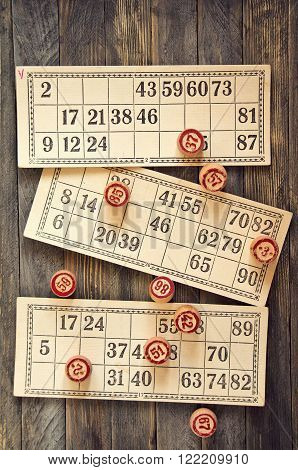 Vintage lotto: kegs and cards on a vintage table