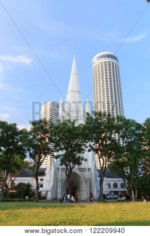 Singapore, Singapore - May 17, 2015: St Andrew's Cathedral steeple and tower. The church is an Anglican cathedral and largest cathedral in Singapore. It is located near City Hall MRT in downtown.