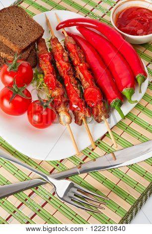 Shashlik On A Plate With Cherry And Chili.