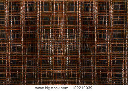 rusty reinforcement on a black background. reinforcing iron bars. abstract geometric pattern