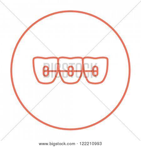 Orthodontic braces line icon.