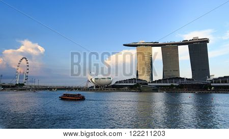 Singapore, Singapore - May 17, 2015: The hotel Marina Bay Sands at the Marina Bay in Singapore. Its a luxury resort famous for its casino and infinity swimming pool. The hotel is one of the landmarks and tourist attractions in Singapore.