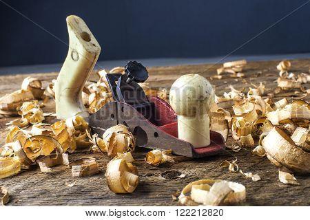 carpenter's plane on a workbench carpenter watch swarf