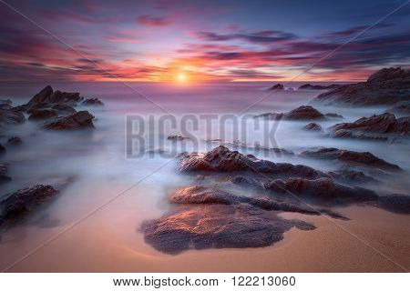 Beautiful sunrise on Greek coast of Aegean sea. Long exposure shot with motion blur effect. Chalkidiki Greece.