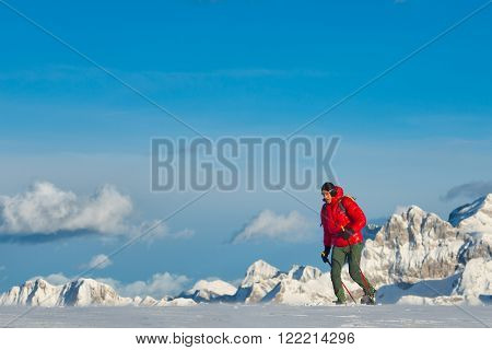 Man with snowshoes in snow in the italian mountains