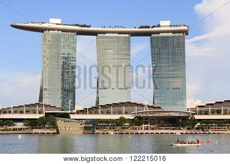 Singapore, Singapore - May 17, 2015: The hotel Marina Bay Sands at the Marina Bay in Singapore with a blue sky. Its a luxury resort famous for its casino and infinity swimming pool. The hotel is one of the landmarks and tourist attractions in Singapore.