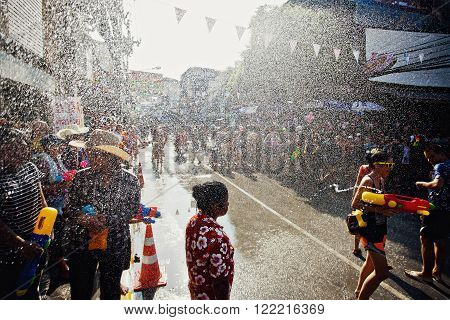 KO SAMUI THAILAND - APRIL 13: Street water fight in a water fight festival or Songkran Festival (Thai New Year) on April 13 2014 in Chaweng Main Road Ko Samui island Thailand.