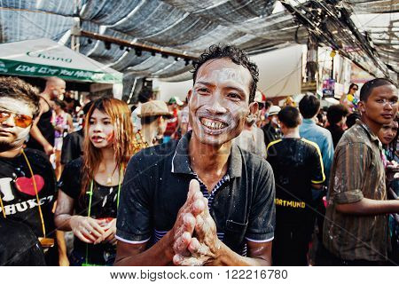 KO SAMUI, THAILAND - APRIL 13: Unidentified man in a thai pose of sawadee krap on Songkran Festival (Thai New Year) on April 13, 2014 in Chaweng Main Road, Ko Samui island, Thailand.