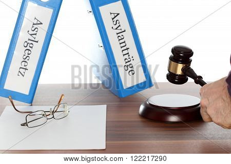 different folders with asylum on a wooden table