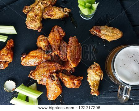 Plate of crispy delicious buffalo chicken wings