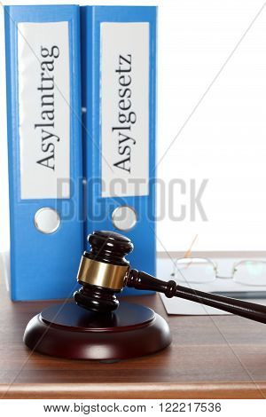 two different folders with asylum and gavel