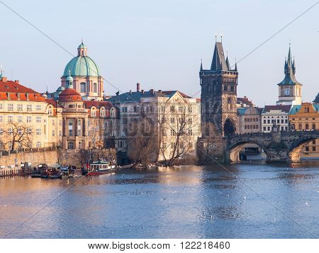 View of Charles Bridge with Old Town Bridge Tower and Church of St Francis of Assisi, Prague, Czech Republic