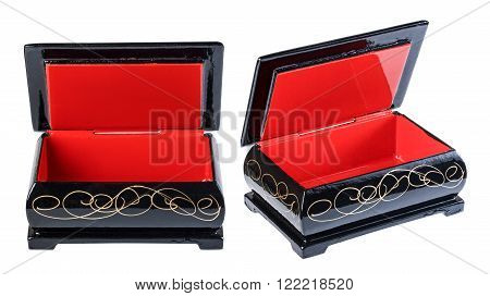 Casket wooden red black open isolate on a white background closeup.