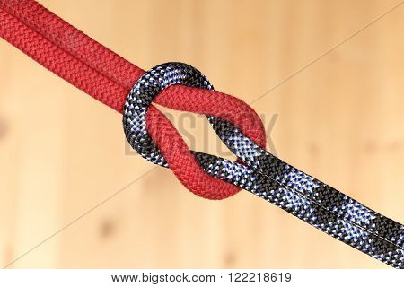 different ropes with knot on wooden plate
