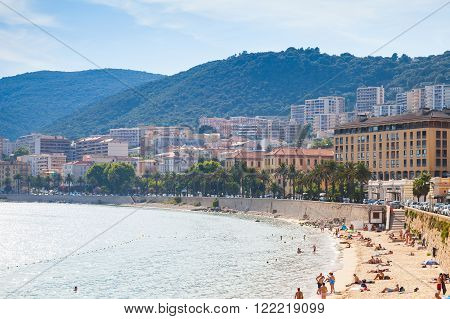 Corsican Cityscape, People Relax On Beach