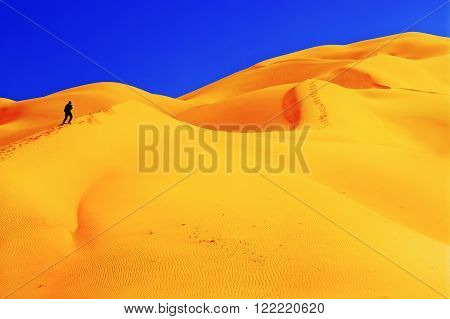 People in desert. landscape with blue sky. Dunes background