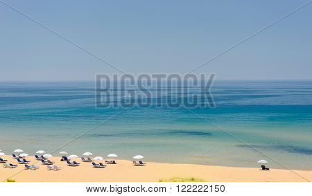 Sun loungers and sun umbrella on the beach