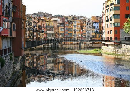 Typical view of girona in catalonia the river onyar and the different painted buildings in front of it