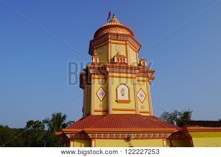 Brightly painted Hindu temple with a swastika in India