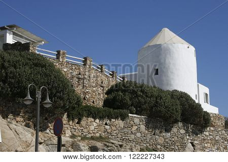 White building against the blue sky. traditional architecture in Mykonos, Greece