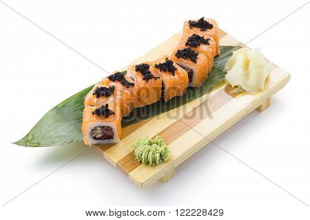 Sushi Roll With Salmon Eel Red Caviar And Black Tobiko On A Bamboo List And Wooden Gete Isolated On