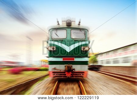 Gradually coming from a distance train motion blur FIG.
