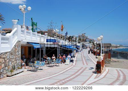 BENALMADENA, SPAIN - JUNE 2, 2008 - View along the cafe lined promenade and beach Benalmadena Costa del Sol Malaga Province Andalusia Spain Western Europe, June 2, 2008.
