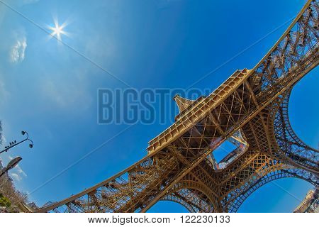 Wide-Angle View from the ground on Eiffel Tower in Paris, France