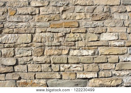 Wall surface of big rough granite boulders fortified by concrete, horizontal photo