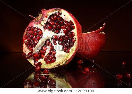 photo red fruit grenades on a dark background