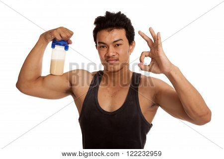 Muscular Asian Man  Flexing Biceps And Show Ok With Whey Protein