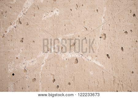 Porous surface texture looks like cement block.