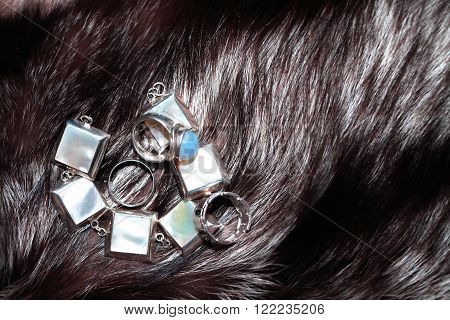 Set of silver adornment on fox fur background