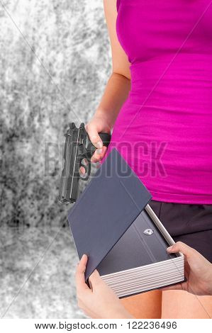 Hand gives safe to another hand holding gun