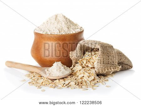 oat wholegrain flour in bowl and spoon bag with oat flakes isolated on a white background closeup