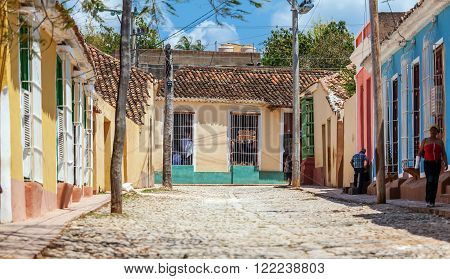 Trinidad, Cuba - March 30, 2012: Native People Waking Near Colorful Casa Homes
