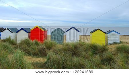 Row of colorful beach huts in British seaside