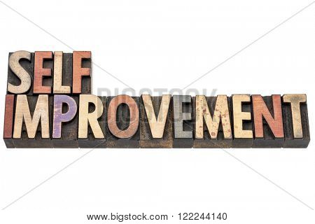 self improvement words  - isolated text in vintage letterpress  wood type printing blocks