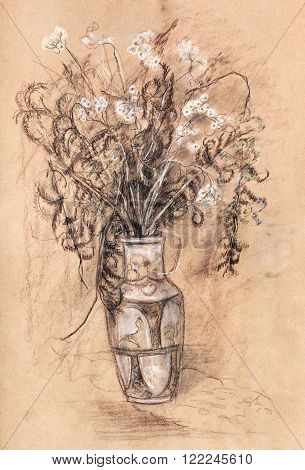 Bouquet of dry flowers in glass vase