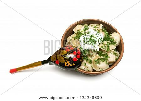 Russian dumplings with sour cream and dill. white background - horizontal photo.