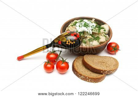 Russian dumplings cherry tomatoes and bread. white background - horizontal photo.