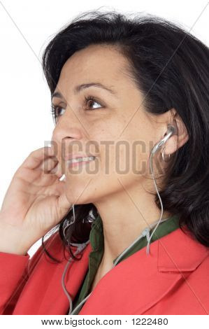 Attractive Girl Listening Music With Earpieces