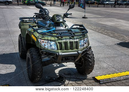 WARSAW POLAND - MAY 08 2015: Arctic Cat 400 4x4 Quad in Polish Land Forces. Public celebrations of 70th Anniversary of End of World War II