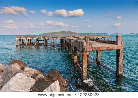 Old pier bridge in the calmness sea at Khao leam ya National park Rayong Province Eastern Thailand