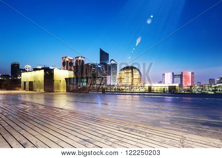 empty wood floor with cityscape and skyline of hangzhou