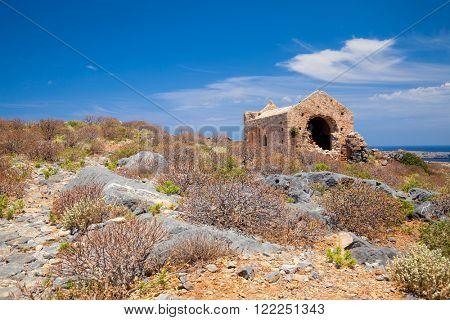 Ruined Venetian church in the fort at Imeri Gramvousa island Crete Greece Mediterranean