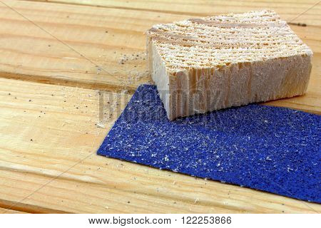 a piece of wood with sandpaper on wood