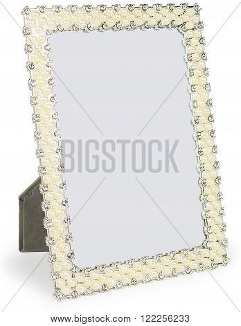 Metal photo frame inlaid with rhinestones and pearl in form with place isolated for your photo.