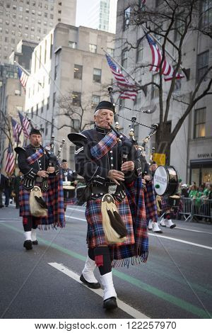 NEW YORK - MARCH 17, 2016: Bagpipers perform in front of St Patricks Cathedral during the parade on Saint Patricks Day in Manhattan on March 17, 2016.