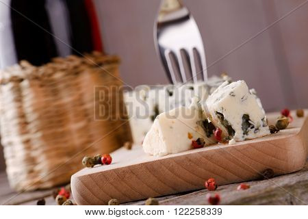 Couple Of Blue Cheese Pieces On Wooden Board
